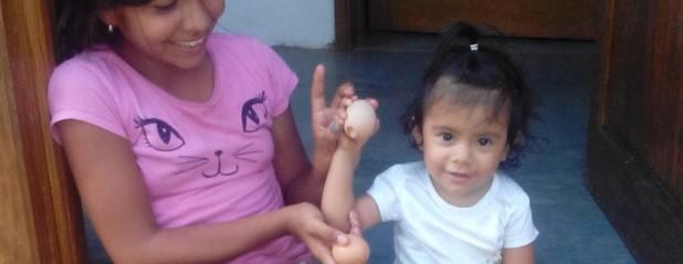CHILDREN RECEIVING EGGS-8