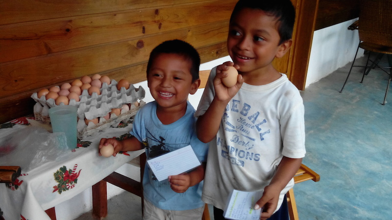 CHILDREN RECEIVING EGGS-9